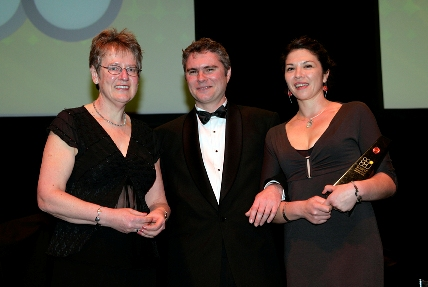 Franz Ombler (middle) and Lavina Edwin (right) receive the 2005 Healthcare award.